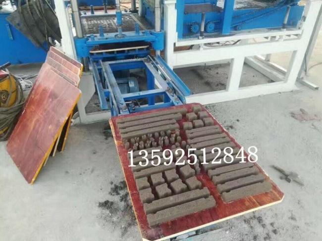 河南宜欣3-15液压水泥垫块机设备